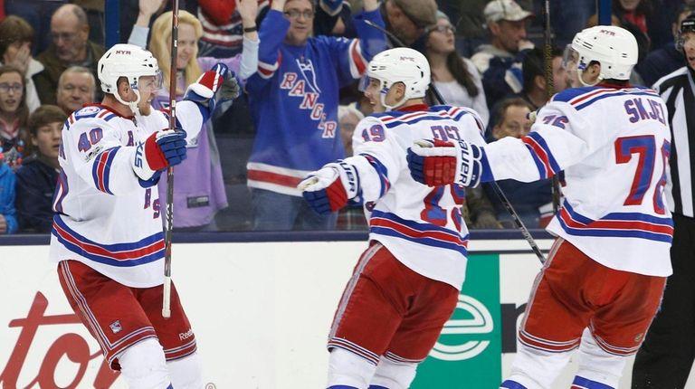New York Rangers' Michael Grabner, left, celebrates his