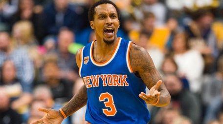 New York Knicks guard Brandon Jennings reacts toward