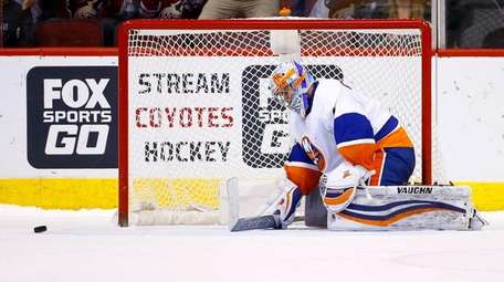 New York Islanders goalie Thomas Greiss pauses on