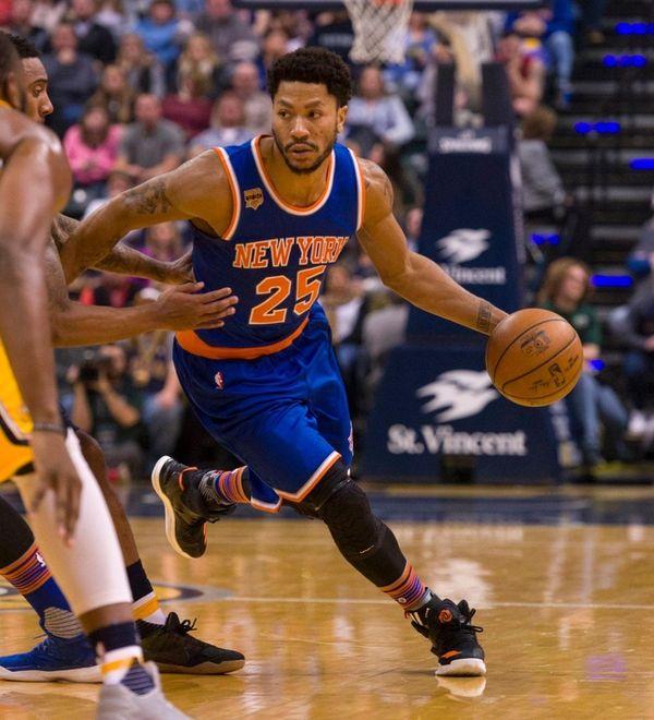 New York Knicks guard Derrick Rose drives the