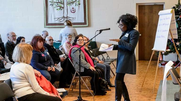 Nora Bassett (R) speaks during a Townhall for