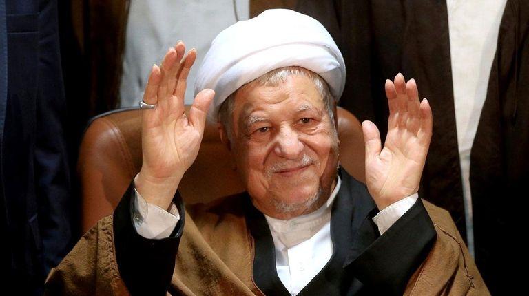 Former Iranian President Akbar Hashemi Rafsanjani waves to