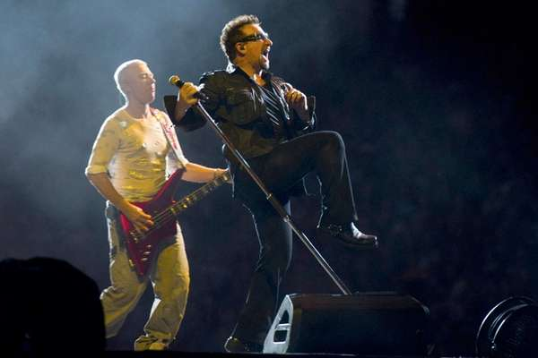 U2's Bono, right, and Adam Clayton, perform as