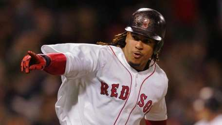 Manny Ramirez points to his dugout as he