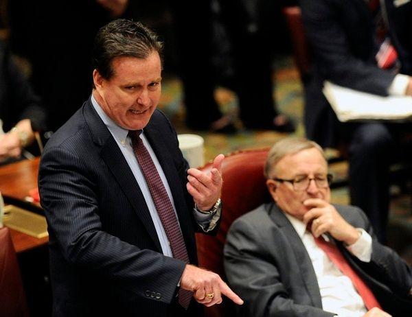Senate Majority Leader John Flanagan, left, speaks to