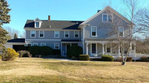 This turn-of-the-century Center Moriches home is listed for