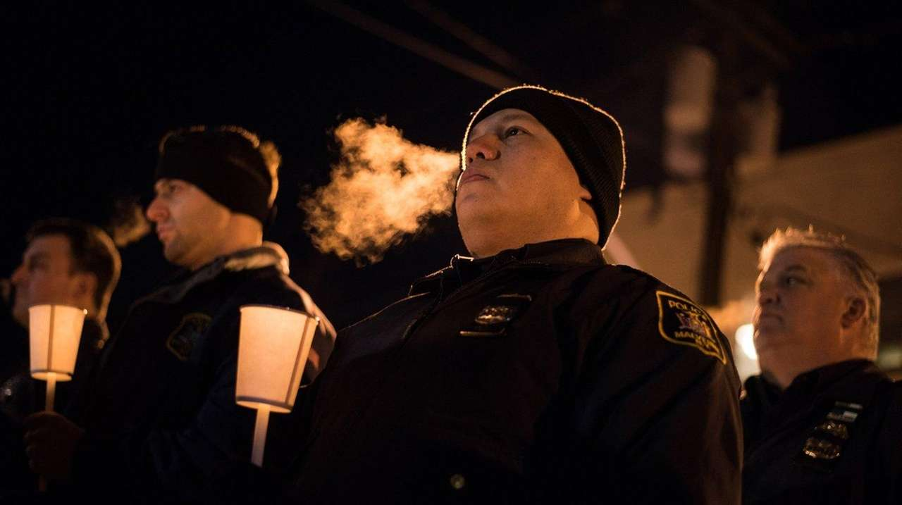Malverne Police Officer Orlando Prado at a vigil