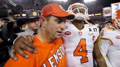 Clemson head coach Dabo Swinney talks to Deshaun