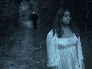 Jessy Perez is followed in the woods by