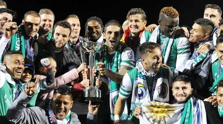 Members of the New York Cosmos celebrate with