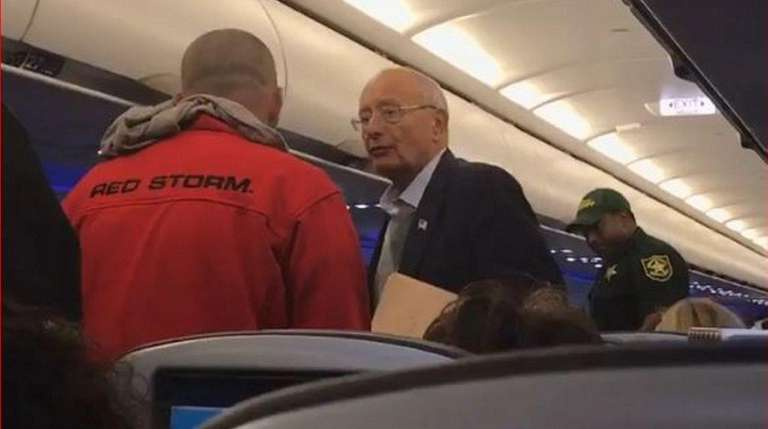 Former Sen. Alfonse D'Amato is removed from a