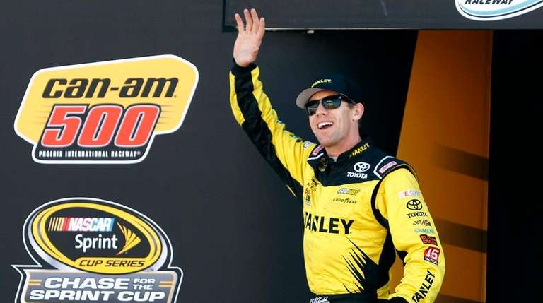 Carl Edwards waves during driver introductions for the
