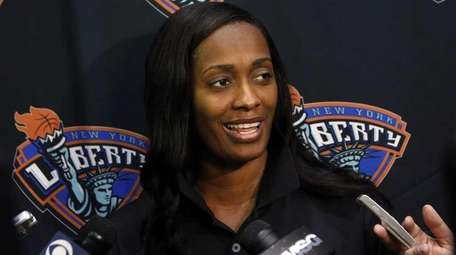 New York Liberty's Swin Cash takes questions during