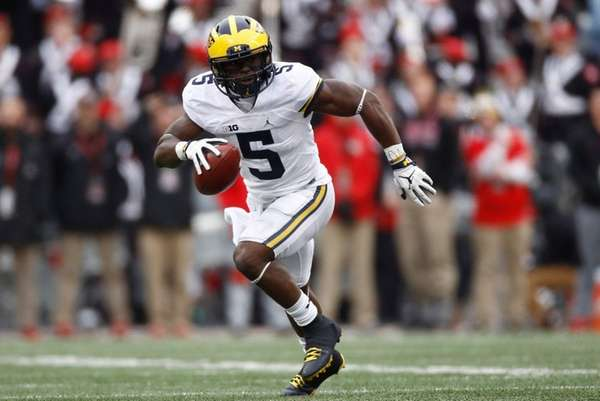 Jabrill Peppers of the Michigan Wolverines runs after