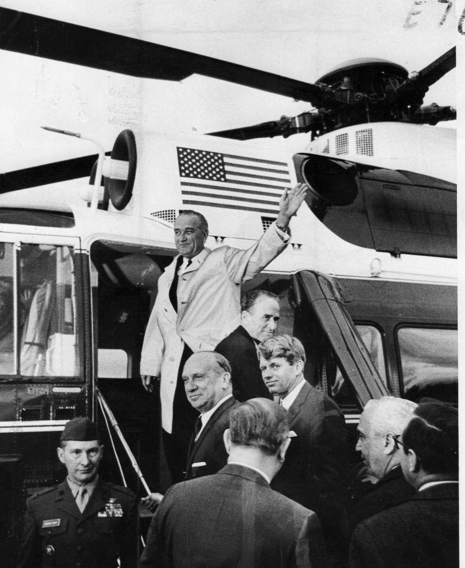 President Lyndon Baines Johnson waves to the crowd
