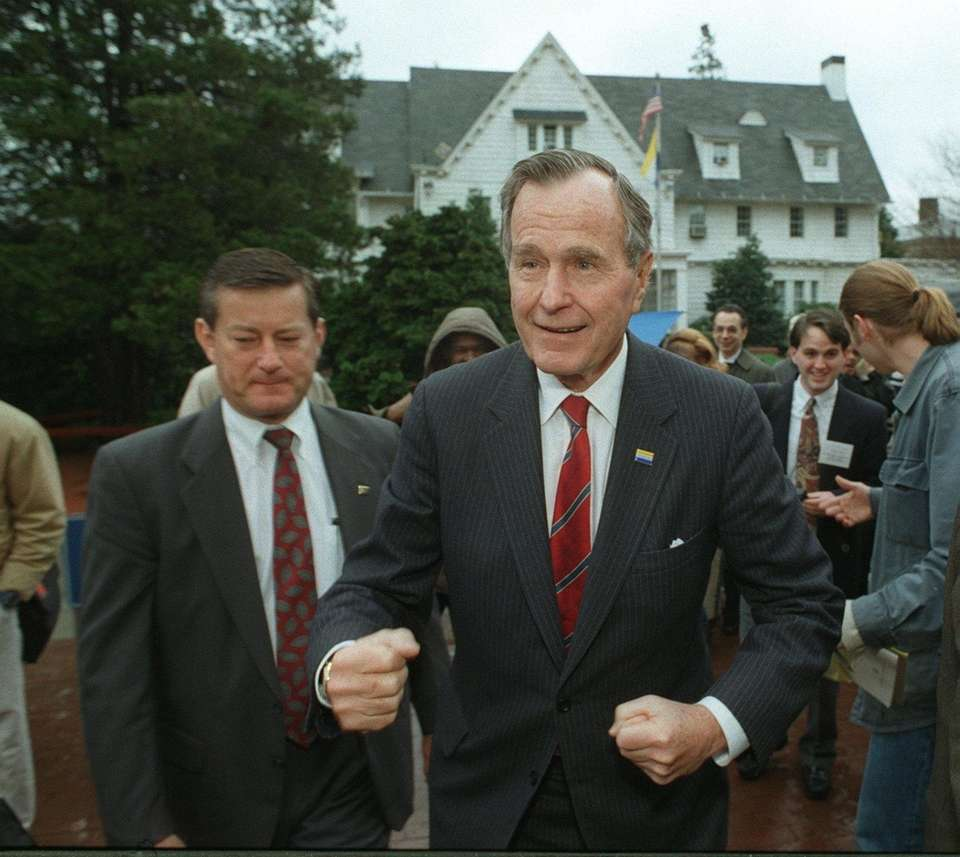 Former President George H.W. Bush walks on the