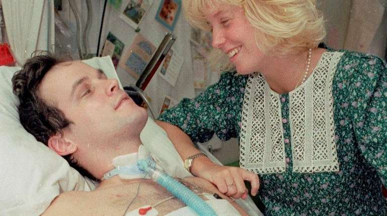 Paralyzed NYPD Officer Steven McDonald with his wife,