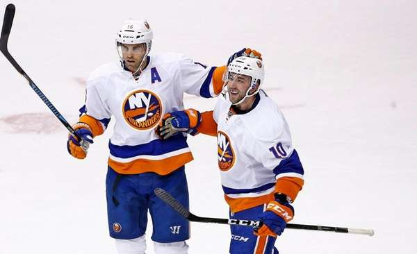New York Islanders center Alan Quine celebrates his