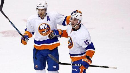 New York Islanders center Alan Quine celebrates his