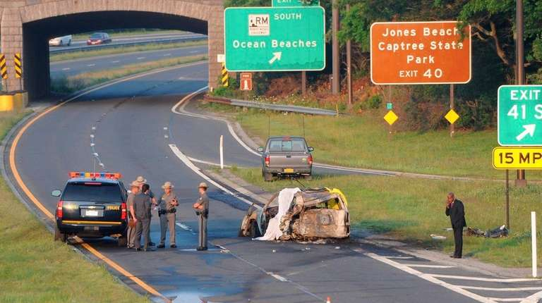 New York State troopers stand at the scene