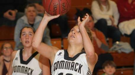 Commack's Jillian Spagnuola (12) puts a shot up