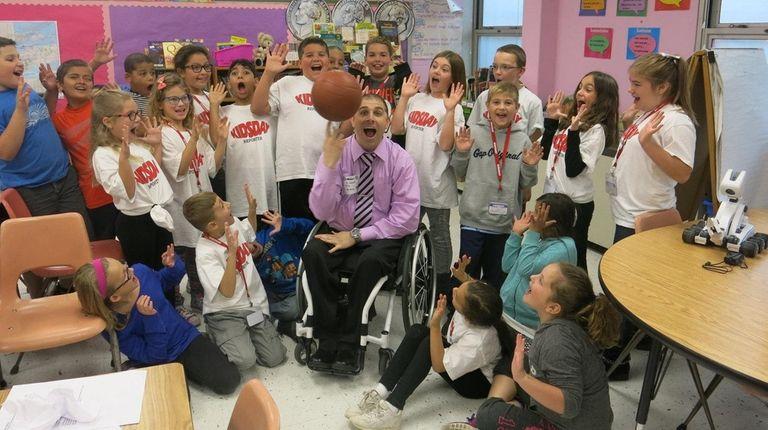Wheelchair athlete Jason Soricelli spins a basketball for