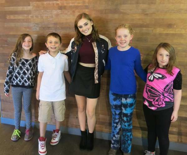 Actress Meg Donnelly poses with Kidsday reporters, from