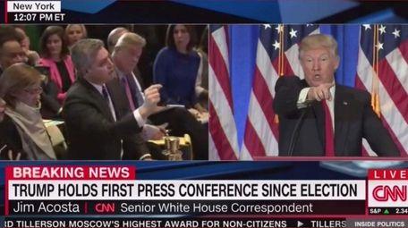 CNN's senior White House correspondent Jim Acosta tries