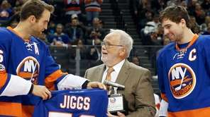 Long time hockey broadcaster Jiggs McDonald is presented