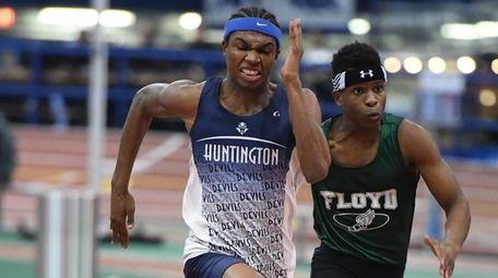 Kyree Johnson of Huntington in lane 5 wins