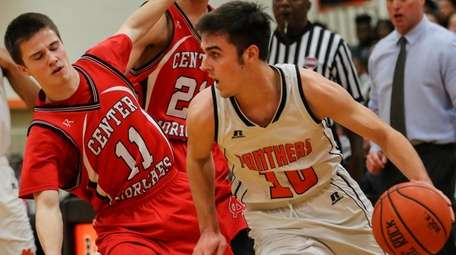Dylan Bryant of Center Moriches defends against the