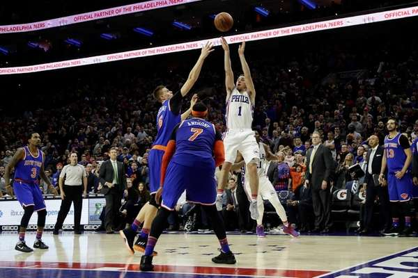 Philadelphia 76ers' T.J. McConnell (1) takes the game-winning