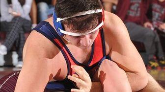 Jake Hunter of MacArthur, top, battles Jon Koenig