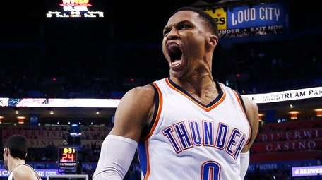Oklahoma City Thunder guard Russell Westbrook (R) reacts