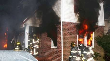 Firefighters respond to a house fire on Donald