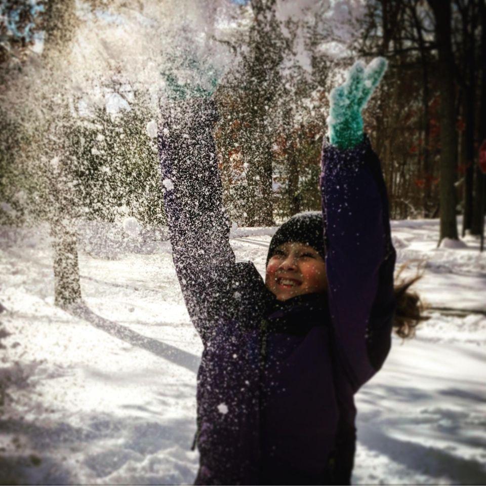 Maya Richards enjoying the snow as her 2