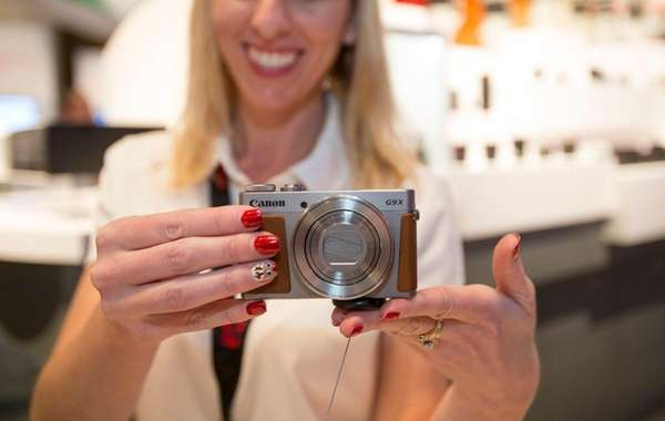 A Canon sales representative demonstrates the new Powershot