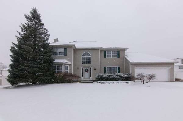 This four bedroom Colonial in Selden is listed