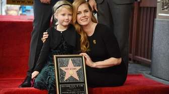 Actress Amy Adams and her daughter Aviana attend