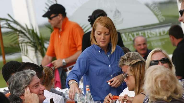 A waitress helps diners on the exterior dining