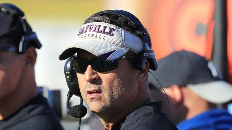 Sayville Head Coach Robert Hoss watches from the