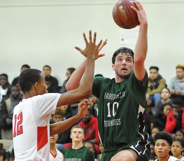 Alex Merhige of Harborfields drives to the basket