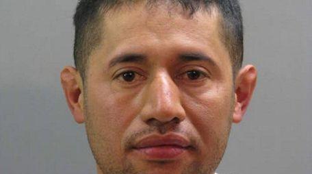 Joel Arquimides Ayala Deras, 35, of Westbury was