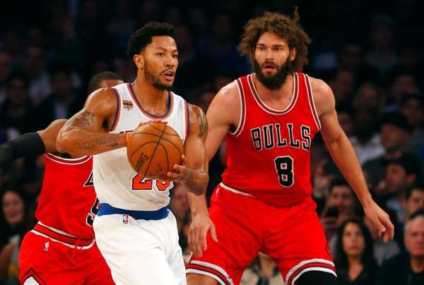 Knicks' Derrick Rose protects the ball during the