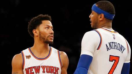 Derrick Rose #25 and Carmelo Anthony #7 of