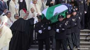 Thousands attended a funeral Mass for NYPD Det.