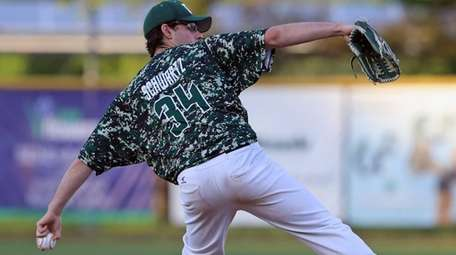 Bellmore JFK pitcher Mike Schwartz #34 delivers the