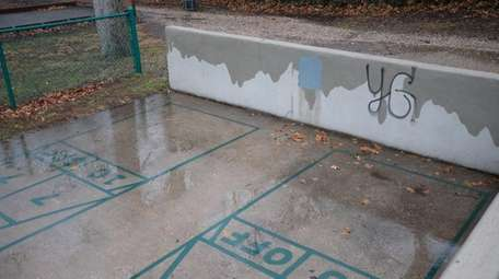 A gray box, recently painted, covers where swastikas