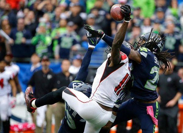 Seattle Seahawks cornerback Richard Sherman breaks up a