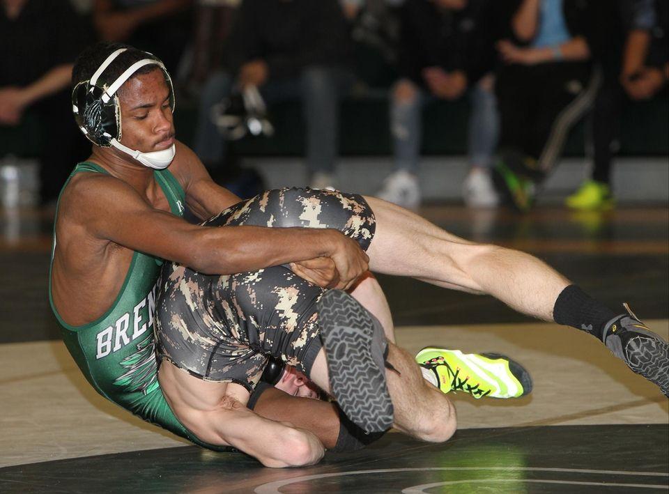 Brentwood's Zyrik Rincon wrestles Ward Melville's Kenny Cracchiola
